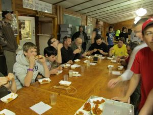 Brothers see who can eat the most wings during the Woodchuck Wing Off at the Woodchuck Ordeal in 2013.